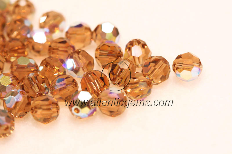 18b984287 5000 - Swarovski Round Bead - 4mm - Light Smoked Topaz AB | Atlantic ...