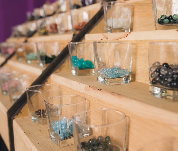 glasses filled with various gemstones
